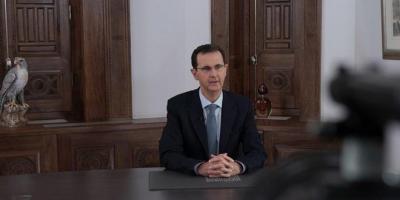 ماذا يعني الرمز الذي ظهر خلف الرئيس الأسد ؟